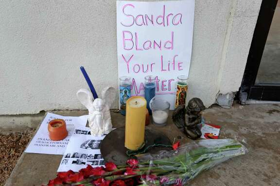 A vigil for Sandra Bland at the entrance to the Waller County Sheriff's Office and County Jail at 701 Calvit St. Wednesday, July 22, 2015, in Hempstead, Texas. Sandra Bland, 28, was found dead in her cell at the Waller County Jail days after she was detained by police during a routine traffic stop.