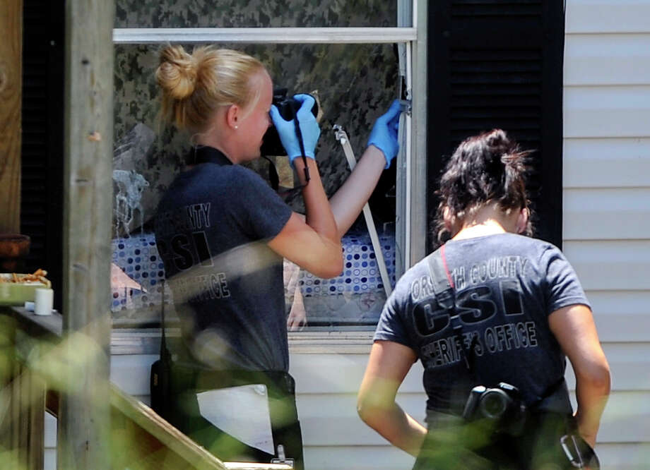 Officers investigate a murder-suicide in Suwanee, Ga. Police had been to the home the previous day. Photo: John Amis / Associated Press / FR69715