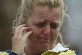 "Stephanie Blancarty of Castro Valley, Ca. cries as a procession of police officers leave Eden Medical Center with the Hayward Police sergeant that was killed early the morning of Wednesday, July 22, 2015. ""I felt the impact of the community sticking together,"" Blancarty says. ""I think being a police officer is a really tough job to have these days."""