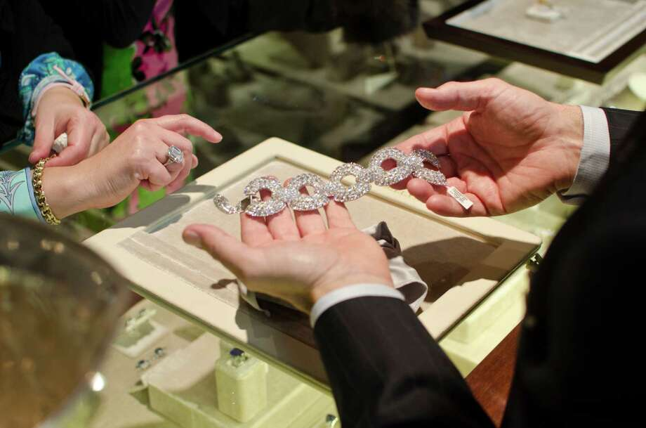 Beautiful jewelry passes hands every day at Betteridge jewelers in Greenwich. The store will quadruple its retail space with a move down Greenwich Avenue. Photo: JAMES KATT / / BETTERIDGE