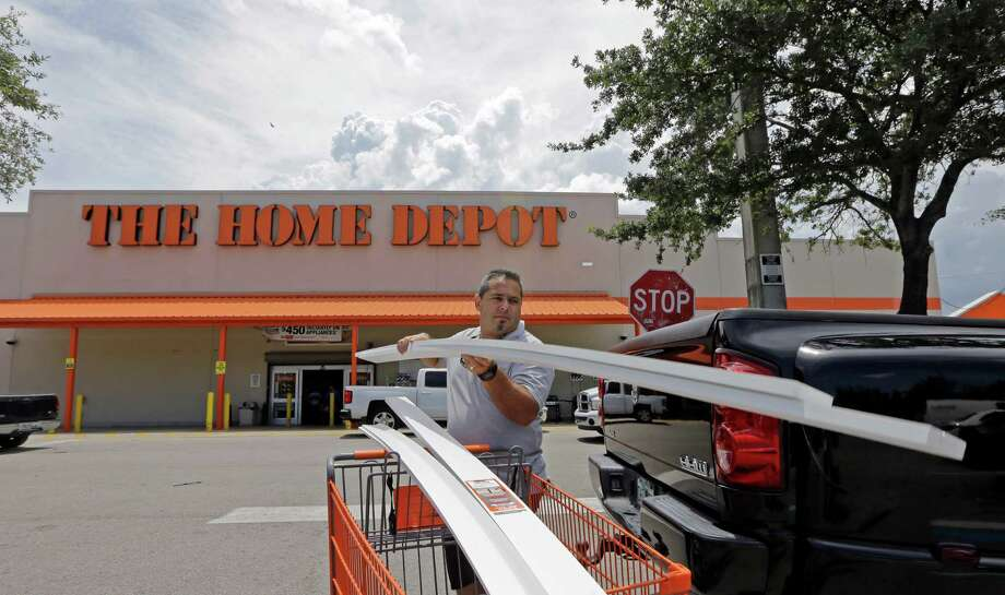 In this photo taken Monday, July 13, 2015, Vicente Aguiar loads garage door trims into his pickup truck outside a Home Depot in Hialeah, Fla. The Home Depot Inc. on Wednesday, July 22, 2015 announced it is buying Interline Brands Inc., which distributes maintenance and repair products, for just under $1.63 billion in cash. (AP Photo/Alan Diaz) ORG XMIT: NYBZ184 Photo: Alan Diaz / AP