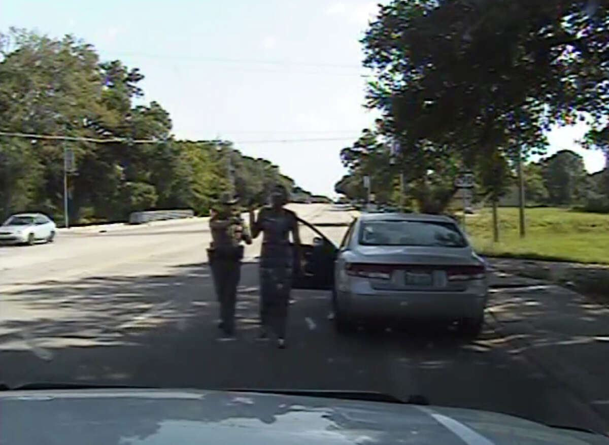 """After the trooper hands Bland the written warning, he remarks that she seems irritated. Bland says she was irritated because she was stopped for changing lanes to get out of the path of the trooper's car. The conversation turns hostile when the officer asks Bland to put out her cigarette and she asks why she can't smoke in her own car. The trooper then orders Bland to get out of the car. She refuses, and he tells her she is under arrest. Further refusals to get out bring a threat from the trooper to drag her out. He then pulls a stun gun and says, """"I will light you up."""" When she finally steps out of the vehicle, the trooper orders her to the side of the road. There, the confrontation continues off-camera but is still audible. The two keep yelling at each other as the officer tries to put Bland in handcuffs and waits for other troopers to arrive. Out of the camera's view, Bland continues protesting her arrest, repeatedly using expletives and calling the officer a """"pussy."""" At one point, she screams that he's about to break her wrists and complains that he knocked her head into the ground. In response to questions about gaps and overlaps in the recording, the Texas Department of Public Safety said the video was not edited or manipulated. Department spokesman Tom Vinger said Wednesday that glitches in the recording arose when it was uploaded for public viewing. He said the department will repost the footage."""