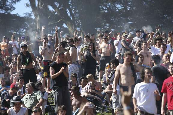 FILE - In this April 20, 2009 file photo, a large crowd cheers as the time reaches 4:20 p.m. on Hippie Hill in Golden Gate Park in San Francisco. A commission led by California Lt. Gov. Gavin Newsom is releasing its recommendations on Wednesday, July 22, 2015, for how marijuana should be grown, sold, taxed and kept out of the hands of minors if voters decide to legalize the drug for recreational use next year. (AP Photo/Jeff Chiu, File)