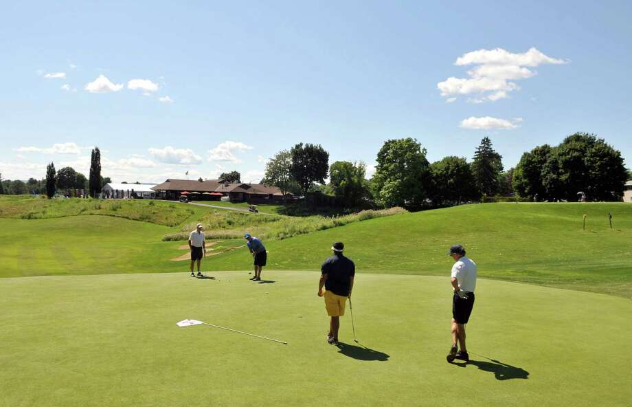 Golfers putt during the pro-am on Wednesday, July 22, 2015, at Capital Hills Golf Course in Albany, N.Y. (Phoebe Sheehan/Special to The Times Union). Photo: PS / 00032712A