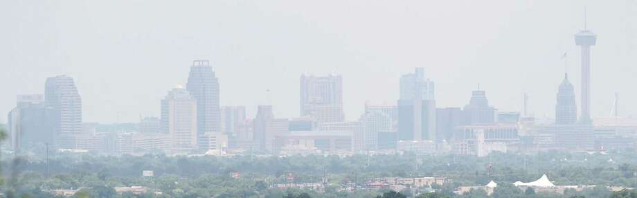 The San Antonio skyline as seen from the roof of the International Bible Church near the intersection of Faith and Benrus streets on the northwest side off Bandera road on July 22, 2015. (International Bible Center maintenance manager Keith Rogers, 210-434-5541, gave us access to vantage point.) Photo: Tom Reel /San Antonio Express-News