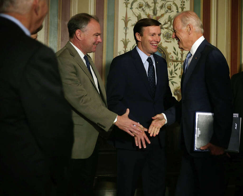 U.S. Vice President Joseph Biden (4th L) arrives at a meeting with Senate Foreign Relations Committee members as he is welcomed by (L-R) Sen. Ben Cardin (D-MD), Sen. Tim Kaine (D-VA) and Sen. Chris Murphy (D-CT) July 16, 2015 at the U.S. Capitol in Washington, DC. Vice President Biden was on the Hill to pitch the Iran nuclear deal. Photo: Alex Wong / Getty Images / 2015 Getty Images