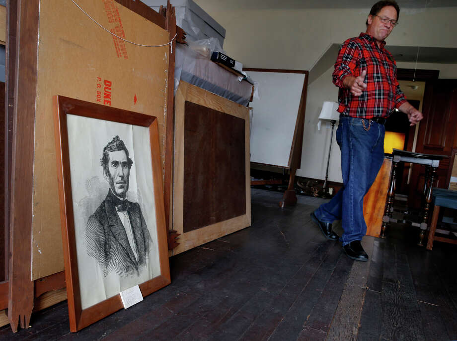 Museum docent Mike Stenberg walks past a portrait of Gen. Braxton Bragg, which is not displayed to the public, at the Guest House Museum in Fort Bragg. Photo: Brant Ward / Photos By Brant Ward / The Chronicle / ONLINE_YES