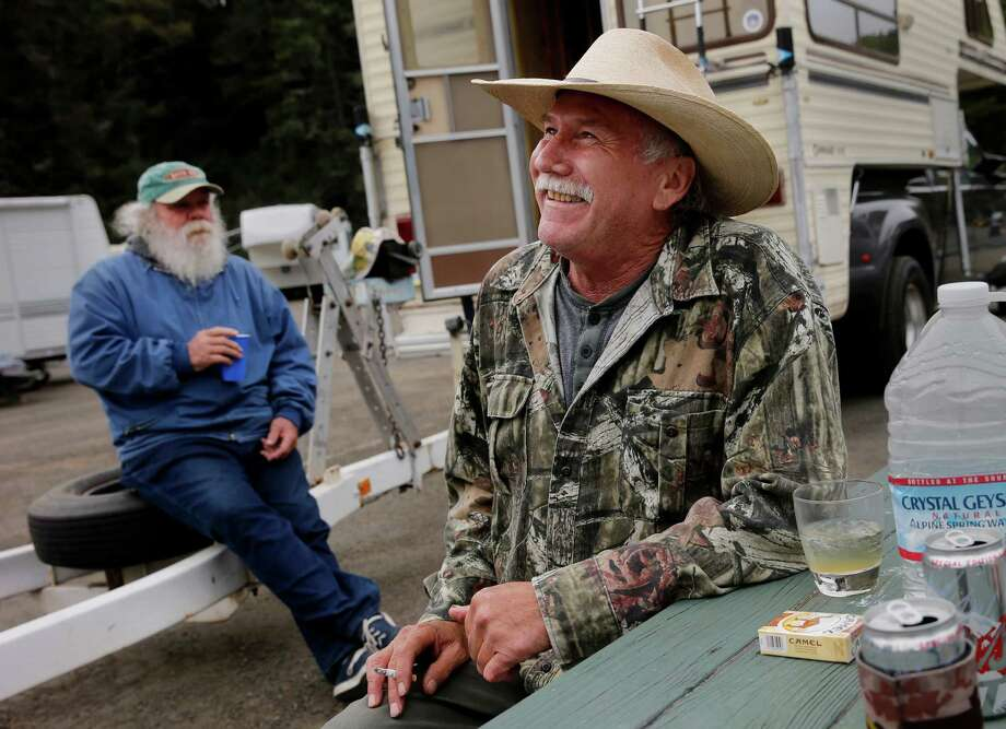 Bill Wright (left) and Anthony Ratti relax in an RV park in Fort Bragg and don't believe a name change for the city they are visiting is in order. Photo: Brant Ward / Brant Ward / The Chronicle / ONLINE_YES