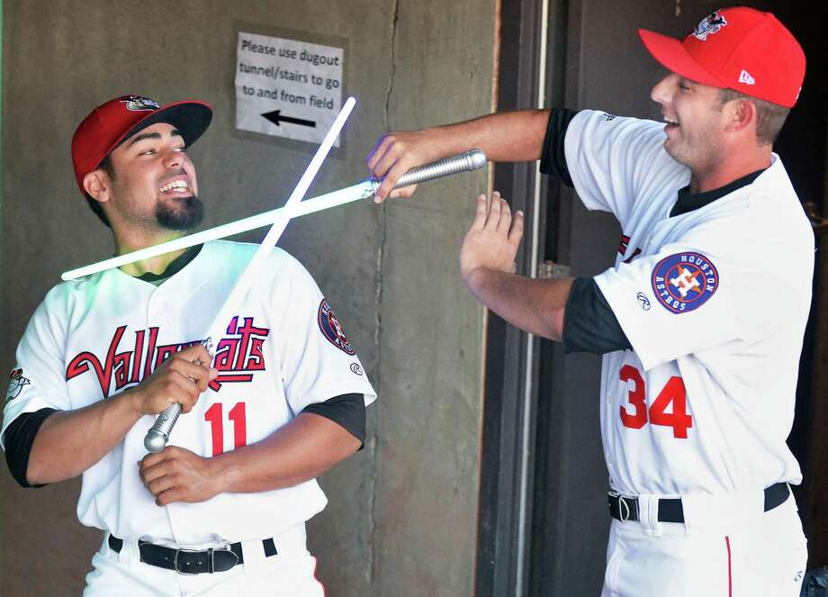 ValleyCats's players Richard Gonzalez, left, and Zac Grotz get into the spirit of Star Wars night at Joe Bruno Stadium in the dugout  before Saturday's game against the Aberdeen IronBirds July 18, 2015 in Troy, NY.  (John Carl D'Annibale / Times Union) Photo: John Carl D'Annibale / 00032630A