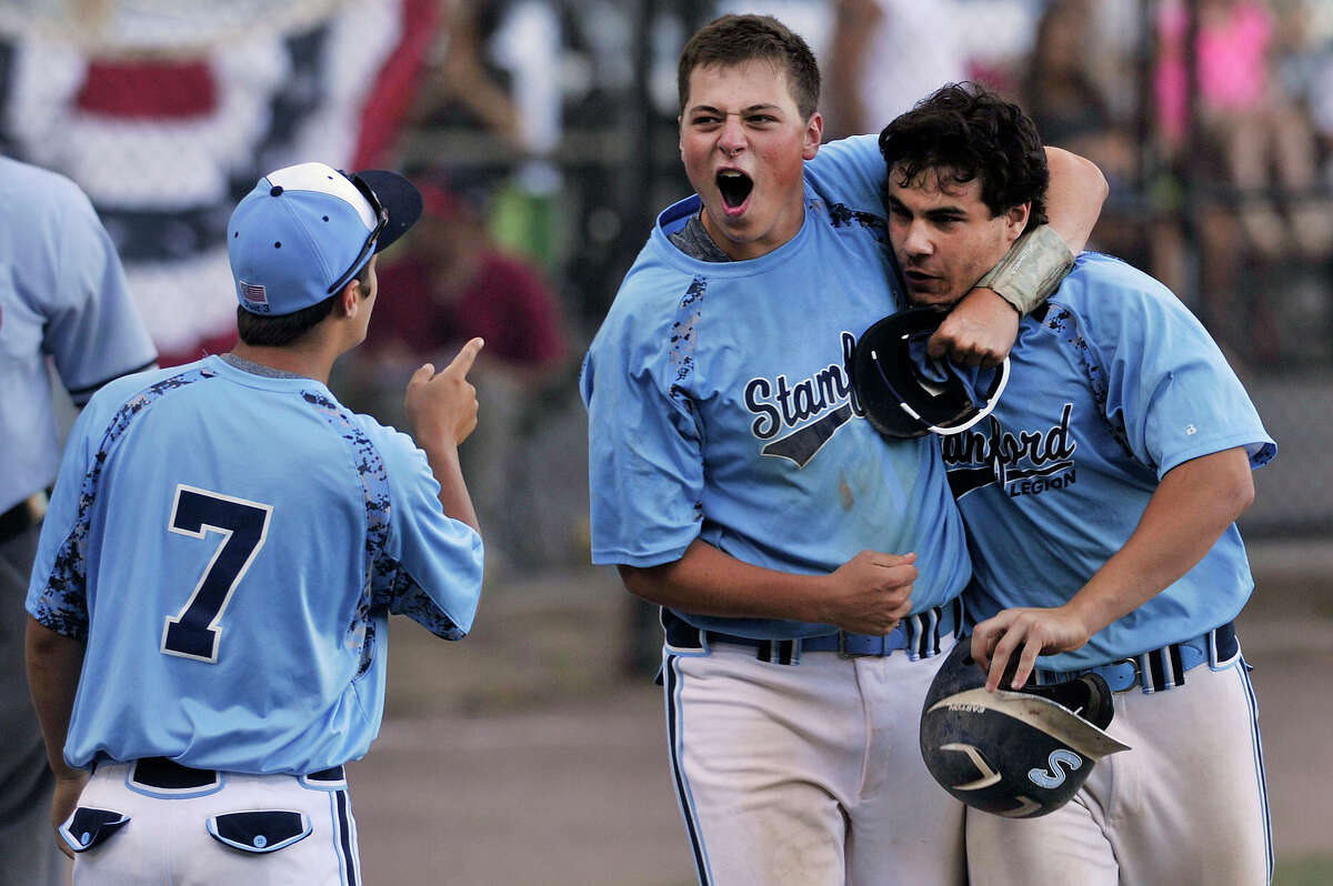 Stamford's Cameron Curto, left, and Peter Horn, center, celebrate after Anthony Frangiose, right, hit a grand slam during their Senior Legion baseball game against Trumbull at Cuebeta Stadium in Scalzi Park in Stamford, Conn., on Wednesday, July 22, 2015. Stamford won, 5-1.