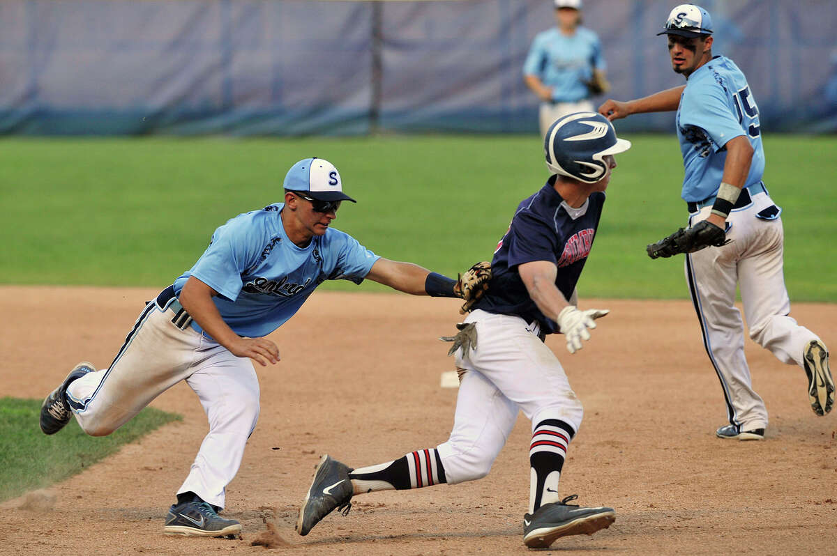 Stamford shortstop Johnny Spoto tags Trumbull's Brian Hnatuk out between first and second base during their Senior Legion baseball game at Cuebeta Stadium in Scalzi Park in Stamford, Conn., on Wednesday, July 22, 2015. Stamford won, 5-1.