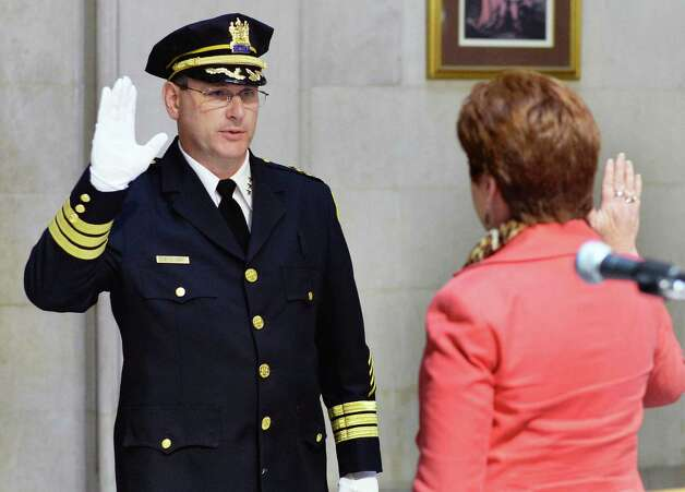 New Police Chief Brendan Cox is sworn-in by Mayor Kathy Sheehan at Albany City Hall Wednesday July 22, 2015 in Albany, NY.   (John Carl D'Annibale / Times Union) Photo: John Carl D'Annibale / 00032714A
