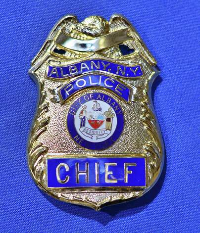 The Chief's badge before ceremonies to swear-in new Albany Police Chief Brendan Cox at Albany City Hall Wednesday July 22, 2015 in Albany, NY.   (John Carl D'Annibale / Times Union) Photo: John Carl D'Annibale / 00032714A