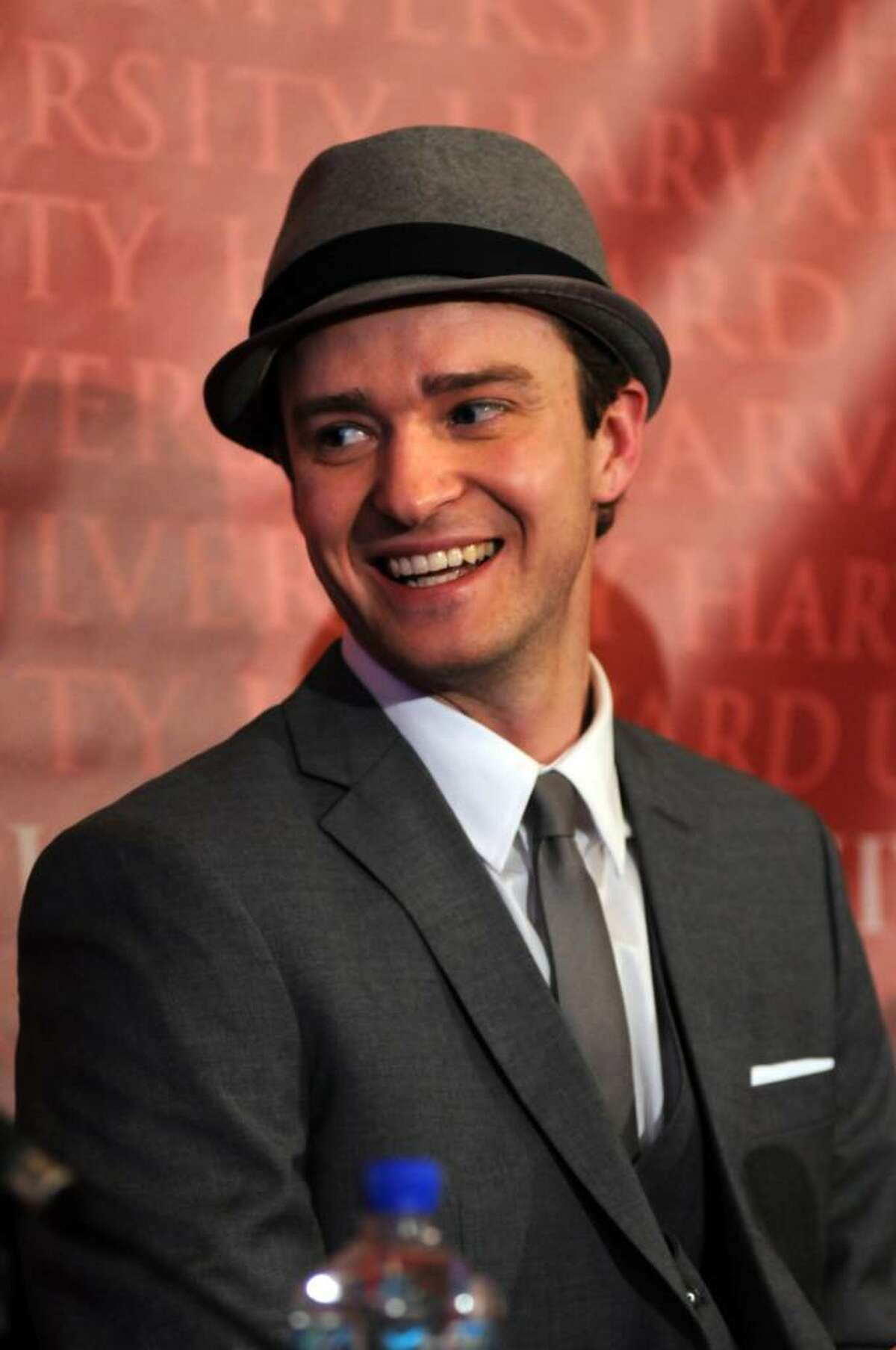 CAMBRIDGE, MA - FEBRUARY 5: Justin Timberlake speaks at a press conference after receiving his Hasty Pudding Pot Man of the Year award at Harvard University on February 5, 2010 in Cambridge, Massachusetts. Timberlake was roasted during a performance from the Hasty Pudding Club theatricals, the oldest college theatrical group in the nation. (Photo by Darren McCollester/Getty Images) *** Local Caption *** Justin Timberlake