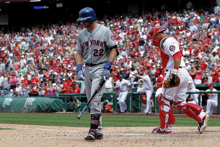 New York Mets' Kevin Plawecki (22) walks away after making the last out as Washington Nationals catcher Wilson Ramos looks on at a baseball game at Nationals Park, Wednesday, July 22, 2015, in Washington. The Nationals won 4-3. (AP Photo/Alex Brandon) ORG XMIT: NAT112 Photo: Alex Brandon / AP