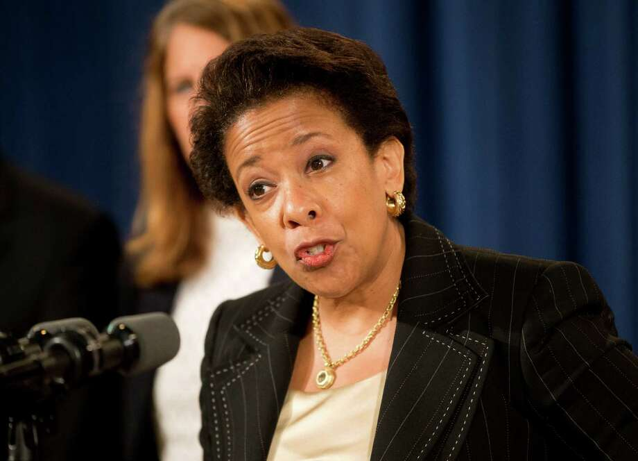 FILE - In this June 18, 2015, file photo, Attorney General Loretta Lynch speaks at a news conference at the Justice Department in Washington. Lynch announced that Dylann Roof, the man accused of slaying of nine black church members in Charleston last month was indicted July 22, on 33 federal counts, including hate crimes, firearms violations and obstructing the practice of religion, which could include the death penalty.  (AP Photo/Pablo Martinez Monsivais, File) ORG XMIT: WX110 Photo: Pablo Martinez Monsivais / AP