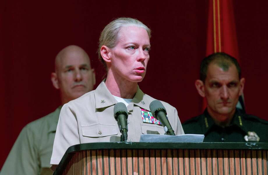 "Rear Adm. Mary M. Jackson, the commander of the Navy Southeast Region, speaks at a news conference in Chattanooga, Tenn., on Wednesday, July 22, 2015, about the shootings that left four Marines one sailor dead. Investigators said they are treating shooter Muhammad Youssef Abdulazeez as a ""homegrown violent extremist,"" but the FBI said it was too early to tell determine if the 24-year-old was ""radicalized"" before the attacks at two military sites. (AP Photo/Erik Schelzig) ORG XMIT: TNES103 Photo: Erik Schelzig / AP"