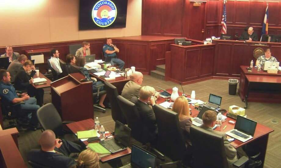 In this image taken from Colorado Judicial Department video, Colorado theater shooter James Holmes, fifth from left rear in light-colored shirt, sits in Arapahoe County District Court, where his trial continued Wednesday, July 22, 2015, in Centennial, Colo. The penalty phase of the trial of Holmes, who could be sentenced to death for killing 12 people in a Colorado movie theater, began Wednesday morning with the judge giving instructions to the jury. (Colorado Judicial Department via AP, Pool) ORG XMIT: COLO301 / POOL Colorado Judicial Department