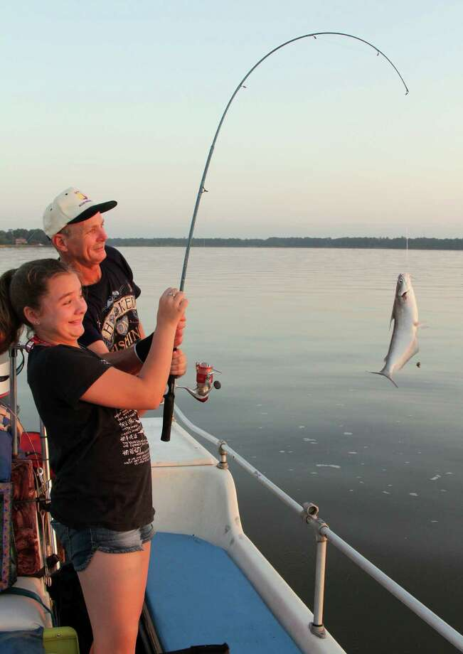Bailey Pratt lifts a channel catfish aboard during a recent trip with her father, guide Walter Pratt, on catfish-rich Lake Houston. Photo: Picasa