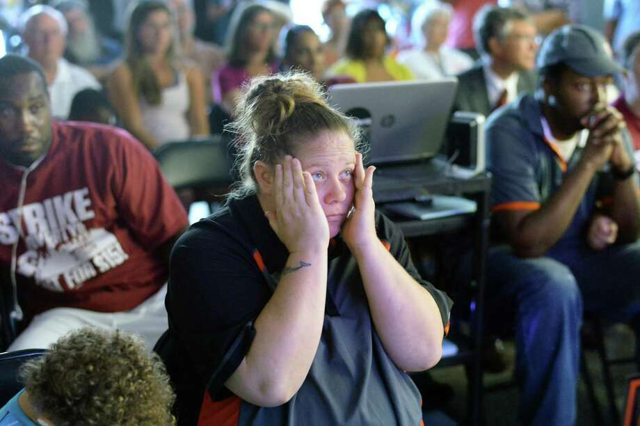 Amanda Monroe, a McDonalds worker from Colonie reacts to the upstate conditions of Gov. Cuomo's The Fast Food Wage Board recommendations during a viewing party at the Citizen Action offices Wednesday July 22, 2015 in Albany, NY.   (John Carl D'Annibale / Times Union) Photo: John Carl D'Annibale / 00032696A