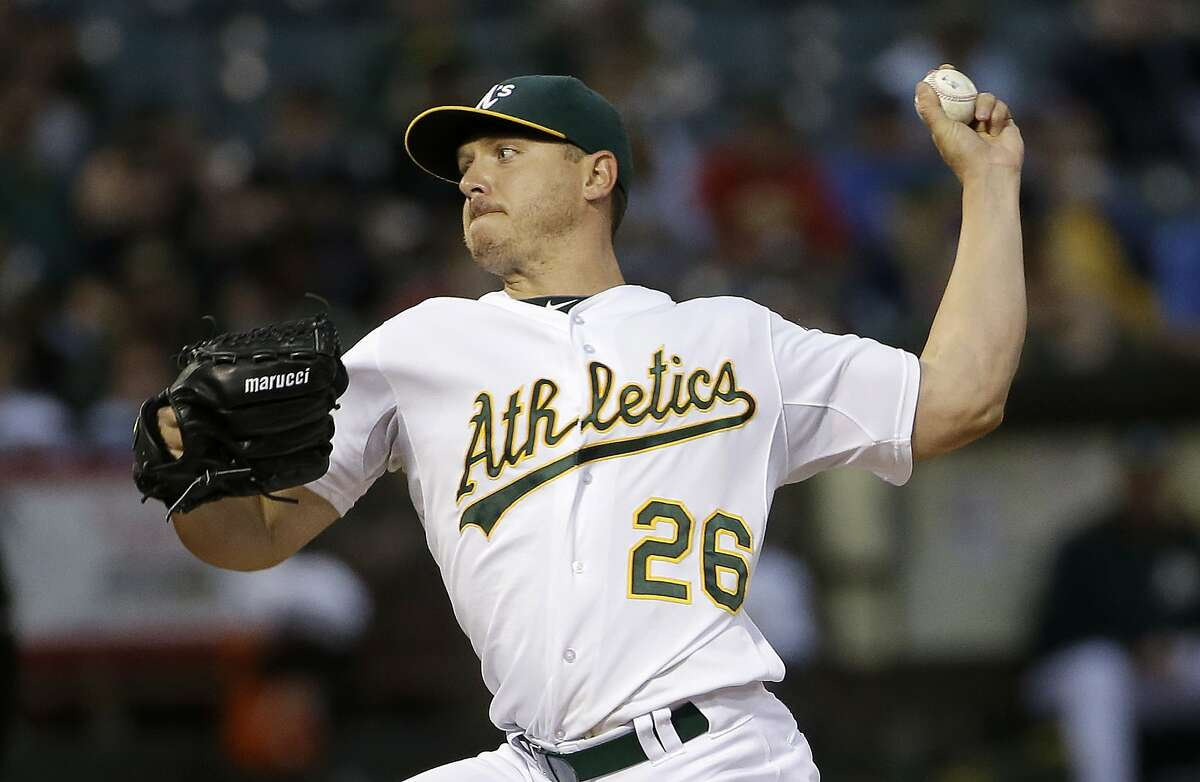 Oakland Athletics pitcher Scott Kazmir throws against the Seattle Mariners during the fifth inning of a baseball game in Oakland, Calif., Thursday, July 2, 2015. (AP Photo/Jeff Chiu)