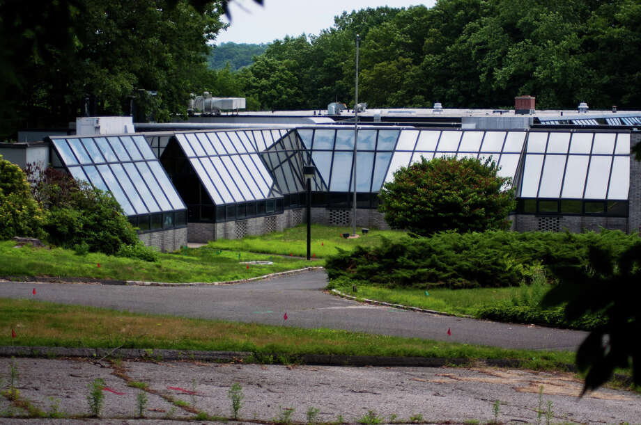 The redevelopment of the Schlumberger-Doll Research Center in Ridgefield could influence the redevelopment of an aging commercial district on Glover Avenue in Norwalk, along with other Fairfield County municipalities having similar opportunities. Photo: File Photo / The News-Times