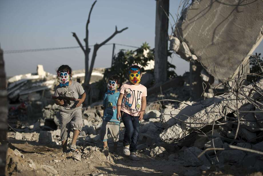 Palestinian children play in the rubble of buildings, reportedly destroyed during the 50-day war between Israel and Hamas militants in the summer of 2014, in Gaza City on July 21, 2015.  Photo: Mohammed Abed, AFP / Getty Images
