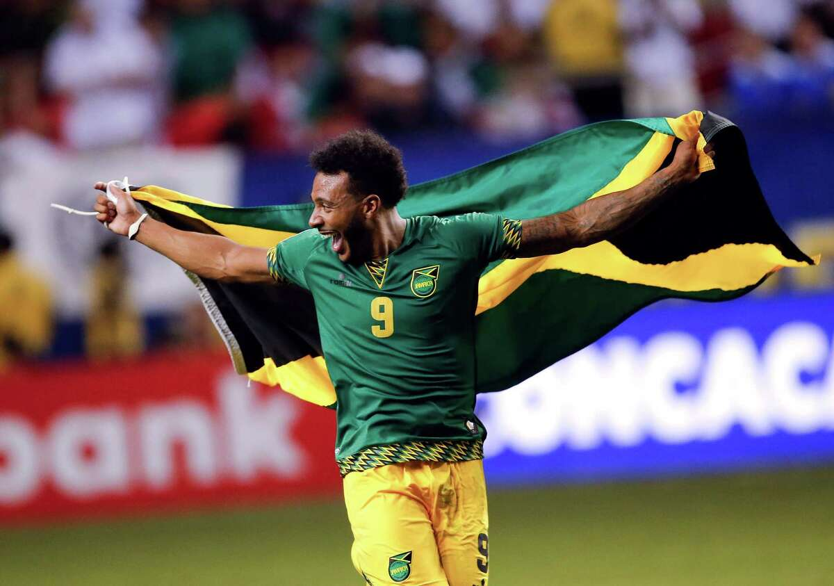 Jamaica's Giles Barnes (9) celebrates after Jamaica defeated the United States 2-1 in a CONCACAF Gold Cup soccer semifinal, Wednesday, July 22, 2015, in Atlanta.
