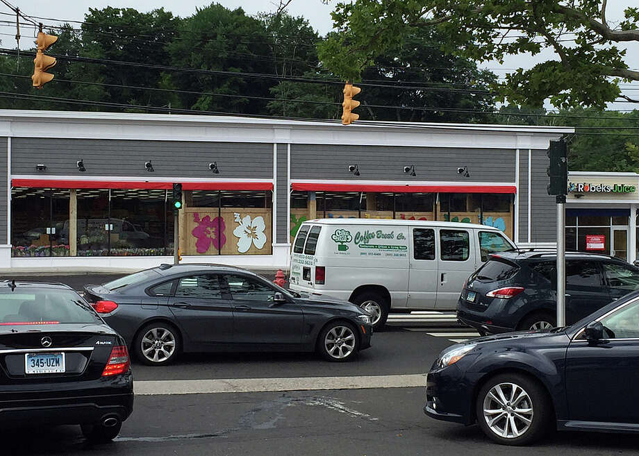"""A typical tangle of traffic """"blocks the box"""" at the Post Road East traffic lights and the parking lot entrances/exits for the Compo Shopping Center, the site of CVS pharmacy. Photo: Arthur Hayes / For Hearst Connecticut Media / Westport News"""