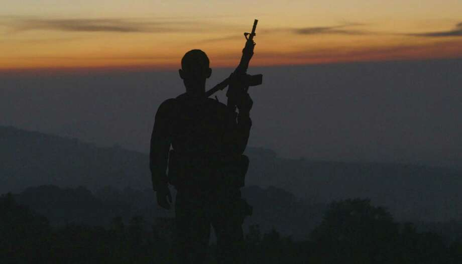 """""""Cartel Land's"""" twin protagonists are vigilantes from two different countries and two different cultures who are determined to fight back against the endemic violence of the Mexican drug cartels. (Handout/TNS) Photo: Handout, HO / McClatchy-Tribune News Service / TNS"""