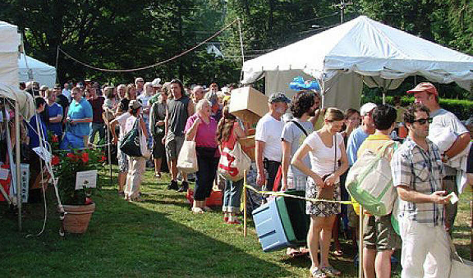 Toeing the line -- crowd waits to gain entry to a previous Summer Book Sale at the Pequot Library. This year's sale opens Friday and runs through Tuesday. Photo: File Photo / File Photo / Fairfield Citizen