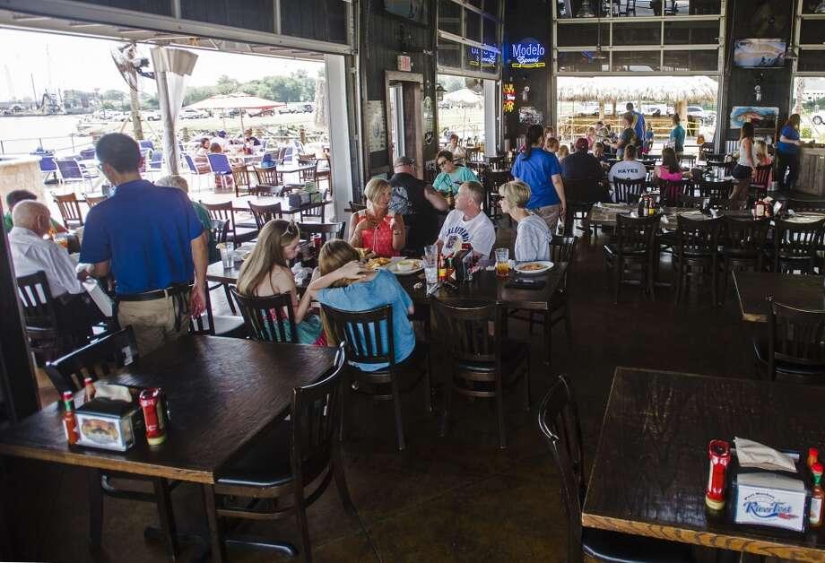 People enjoy an early meal at the Neches River Wheelhouse on Saturday morning. The Neches River Wheelhouse serves brunch on Saturday and Sunday from 10 a.m. to 2 p.m. and offers brunch seating in their new Paiapa outdoor section. Photo taken Saturday 6/6/15 Jake Daniels/The Enterprise Photo: Jake Daniels/The Enterprise