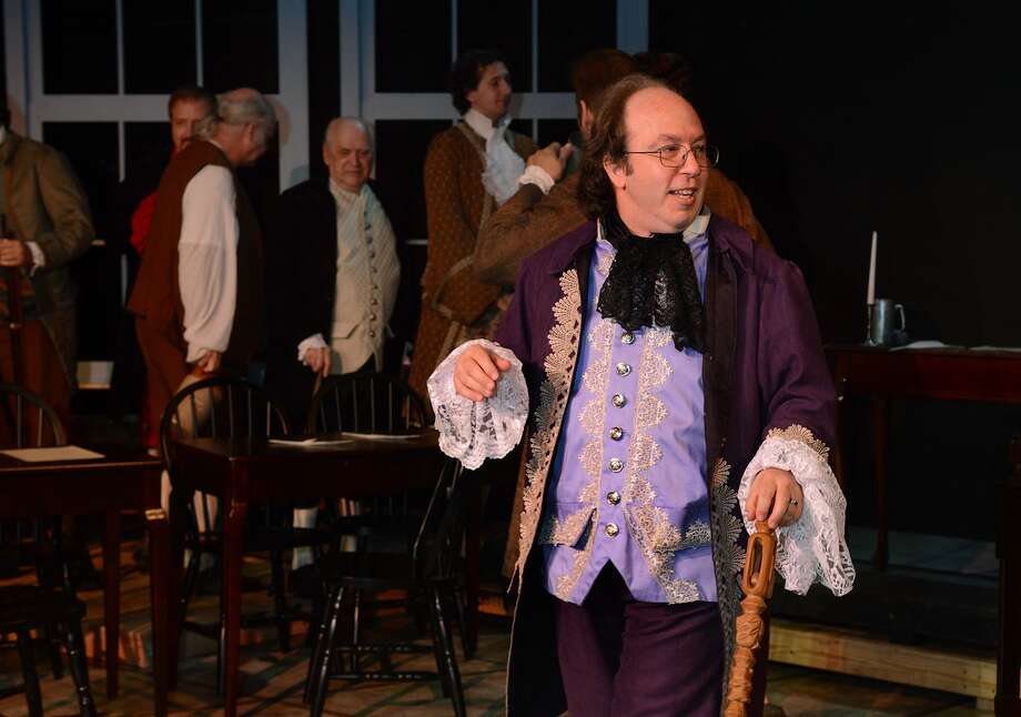 "Cast members of the summer play ""1776"", including Sean Thompson of The Woodlands as Ben Franklin, rehearse on the Garza Main Stage for the Houston Family Arts Center performance on stage this month. Photo: Jerry Baker, Freelance"