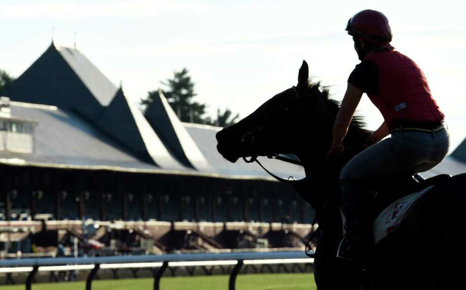 Assistant trainer Tracy Wilkes goes out to the main track for morning exercise Thursday July 23, 2015 at the Saratoga Race Course in Saratoga Springs, N.Y.  Friday is opening day for the meeting will will have 40 days of racing over six weeks.    (Skip Dickstein/Times Union) Photo: SKIP DICKSTEIN / 00032589A