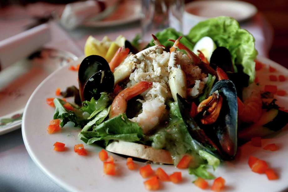 Homemade salad with fruit and seafood or meat is an example of the type of dish found on the NIH study's minimally processed menus. Photo: Gary Coronado, Staff / © 2015 Houston Chronicle