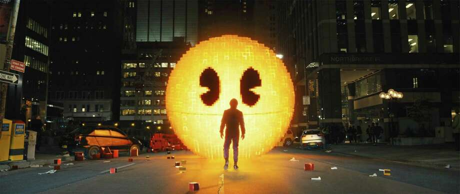 "Pac-Man in a scene from ""Pixels."" Pac-Man in Columbia Pictures' PIXELS. Photo: Sony Pictures, PIXELS / © 2015 CTMG, Inc.  All Rights Reserved. **ALL IMAGES ARE PROPERTY OF SONY PICTURES ENTERTAINMENT INC. FOR PROMOTIONAL USE ONLY."