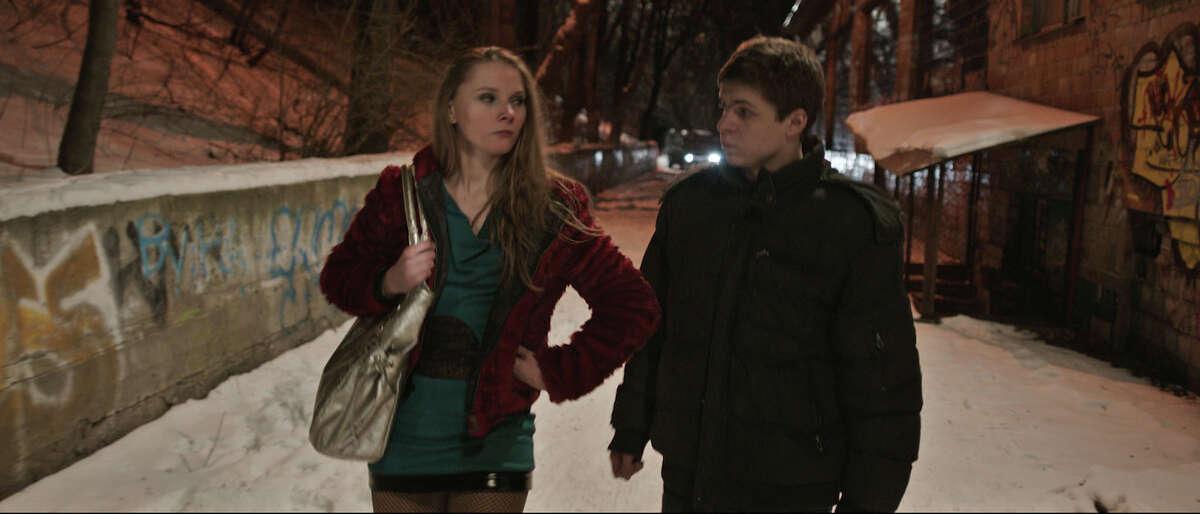 Anya (Yana Novikova) regards new classmate-pimp Sergey (Grigoriy Fesenko) with skepticism in