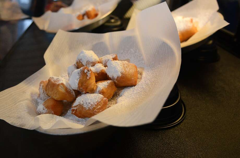 Fresh beignets decorate the display case at LouLou's Beignets on Friday, July 17, 2015. The New Orleans-style coffee and beignet shop recently opened in the Alden Bridge Village Shopping Center in The Woodlands. (Photo by Jerry Baker/Freelance) Photo: Jerry Baker, Freelance