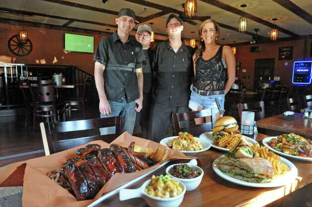 The staff  Chris Bullis, left, Michael Morrow, Chris Davies and Nicole Schifino, right, at the Bull & Barrel Smokehouse at 155 Wade Road on Thursday July 16, 2015 in Latham, N.Y. (Michael P. Farrell/Times Union) Photo: Michael P. Farrell / 00032624A