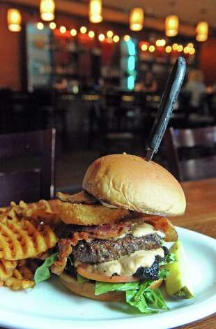 The Texas heartbreaker burger at the  Bull & Barrel Smokehouse at 155 Wade Road on Thursday July 16, 2015 in Latham, N.Y. (Michael P. Farrell/Times Union) Photo: Michael P. Farrell / 00032624A