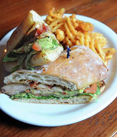 A smoked turkey sandwich at the  Bull & Barrel Smokehouse at 155 Wade Road on Thursday July 16, 2015 in Latham, N.Y. (Michael P. Farrell/Times Union) Photo: Michael P. Farrell / 00032624A
