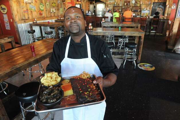 Executive Chef Aloubert Legros at The Barrel Saloon at 942 Broadway on Thursday July 16, 2015 in Albany, N.Y. (Michael P. Farrell/Times Union) Photo: Michael P. Farrell / 00032623A