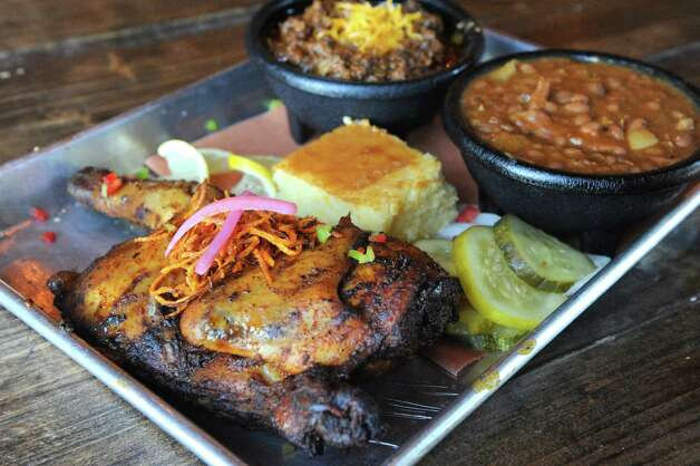 Barbaqued smoked 1/2 chicken with sides of house made chili and baked beans at The Barrel Saloon at 942 Broadway on Thursday July 16, 2015 in Albany, N.Y. (Michael P. Farrell/Times Union) Photo: Michael P. Farrell / 00032623A