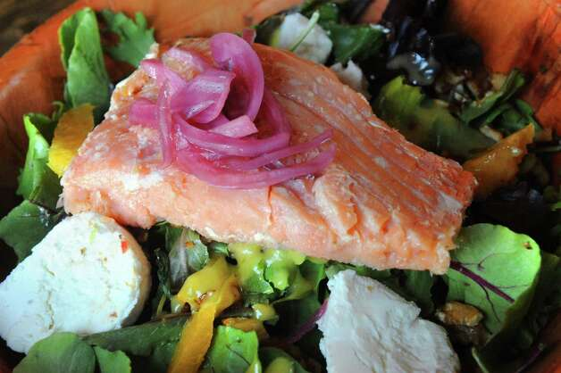 Smoked salmon salad with goat cheese, orange segments and candied walnuts at The Barrel Saloon at 942 Broadway on Thursday July 16, 2015 in Albany, N.Y. (Michael P. Farrell/Times Union) Photo: Michael P. Farrell / 00032623A