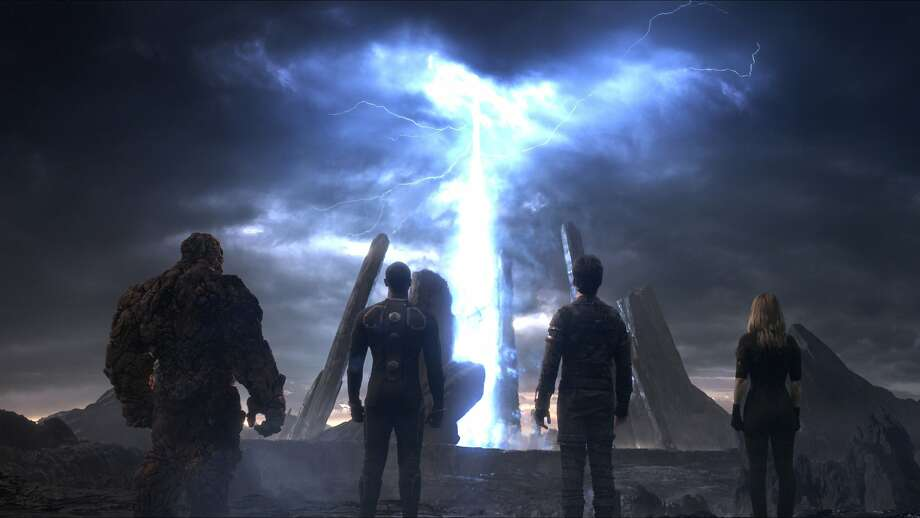 """This photo provided by courtesy Twentieth Century Fox shows, The Thing, from left, Michael B. Jordan as Johnny Storm, Miles Teller as Dr. Reed Richards, and Kate Mara as Sue Storm, in a scene from the film, """"Fantastic Four,"""" releasing in U.S. theaters on Aug. 7, 2015. The Fox panel is on Saturday, July 11, 2015, at the San Diego Convention Center during the Comic-Con International. (Twentieth Century Fox via AP) Photo: Courtesy Twentieth Century Fox, Associated Press"""