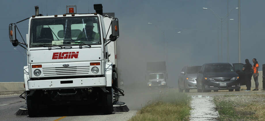 A street sweeper travels Thursday July 23, 2015 on eastbound highway 151 near Callaghan Road after there were reports of spilled nails on the highway and several cars in the area with flat tires. Photo: John Davenport, San Antonio Express-News / ©San Antonio Express-News/John Davenport