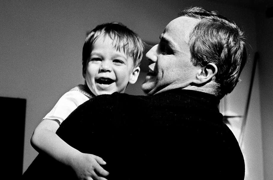 Brando holds son Christian, who as an adult went to prison for fatally shooting Cheyenne's boyfriend. Photo: Showtime, SHOWTIME