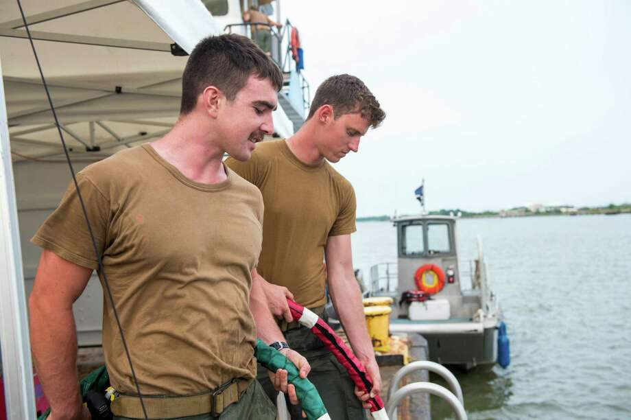 Navy Diver 3rd Class Kevin Kollar. 150721-N-XJ695-038 SAVANNAH, Ga. (July 21, 2015) Navy Diver 3rd Class Kevin Kollar, of Fairfield Conn., and Navy Diver 3rd Class Frank Ormonde, of Kailua, Hawaii, tend the umbilical of divers in the Savannah River in support of the salvage of Civil War ironclad CSS Georgia. Navy divers from Mobile Diving and Salvage Unit 2 (MDSU2) and explosive ordnance disposal technicians from Explosive Ordnance Disposal Mobile Unit (EODMU) 6 are working in conjunction with archaeologists, conservationists, Naval History and Heritage Command, and the U.S. Army Corps of Engineers in a project directed by Naval Sea Systems Command (NAVSEA) Supervisor of Salvage and Diving (SUPSALV) to salvage and preserve CSS Georgia. (U.S. Navy photo by Mass Communication Specialist 2nd Class Jesse A. Hyatt/Released) Photo: U.S. Navy / U.S. Navy / Connecticut Post