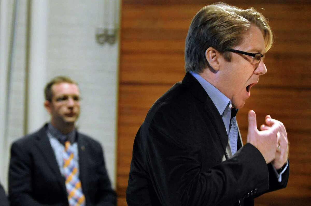 """Baritone Daniel Belcher, right, performs a song from the opera """"The Long Walk"""" on Thursday, March 12, 2015, at the New York State Military Museum in Saratoga Springs, N.Y. Joining him is author Brian Castner. A reading, discussion and performance introduced an opera based on Castner's Iraq War memoir that's being developed by Opera Saratoga. (Cindy Schultz / Times Union)"""