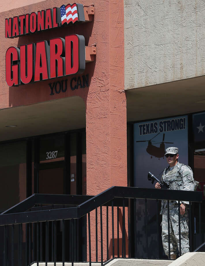 Armed Texas Army National Guardsmen are in front of recruiting office Thursday July 23, 2015 on the 3200 block of Wurzbach Road. Photo: John Davenport, San Antonio Express-News / ©San Antonio Express-News/John Davenport